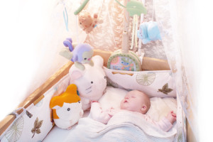 Beautiful baby sleeping - buy the best nanny cam for your family - glider for small nursery
