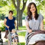 Beautiful Mother Pushing Baby Stroller In Park - stroller organizer bag